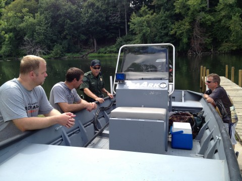Travis and team drooling over the Michigan DNR Jet Boat after the River Dive