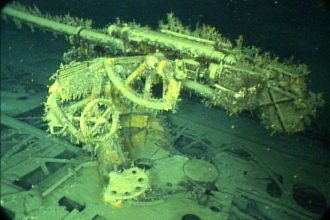 A deck gun of the sunken German U-boat U-166. Photo Credit: NOAA photo library: http://www.photolib.noaa.gov/htmls/expl4047.htm